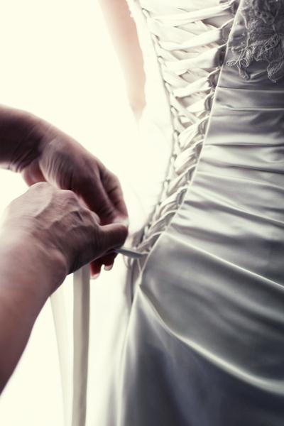 Tying a wedding dress